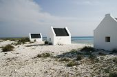 stock photo of slave-house  - Historical white slave houses on the coast of Bonaire - JPG