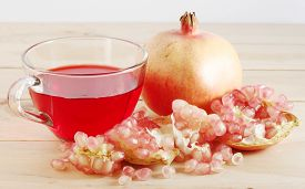 stock photo of pomegranate  - Pomegranate fruit is eaten as a sweet or sour and sweet pomegranate is a fruit that have health benefits - JPG
