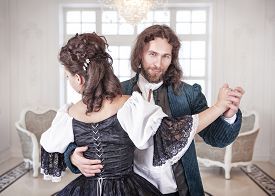 pic of pompous  - Beautiful couple woman and man in medieval clothes in the room - JPG