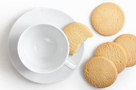 stock photo of shortbread  - Empty white cup and saucer with shortbread biscuits from above - JPG