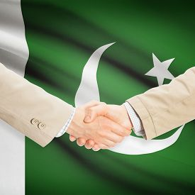 picture of pakistani flag  - Businessmen shaking hands with flag on background  - JPG