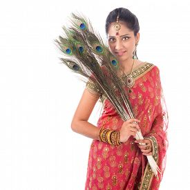 image of female peacock  - Portrait of beautiful Indian woman holding peacock feathers - JPG