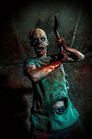 pic of doomsday  - Horrible scary zombie man on the ruins of an old house - JPG
