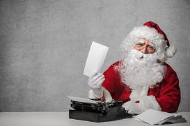 pic of letters to santa claus  - Santa Claus typing a letter on an old typewriter - JPG