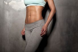 picture of abdominal  - Fitness female woman with muscular body do her workout abs abdominals - JPG