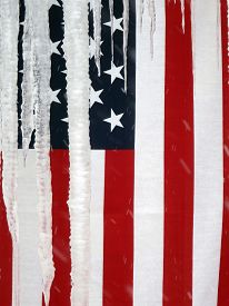 image of disrespect  - A USA National Flag is attached to the exterior yellow - JPG