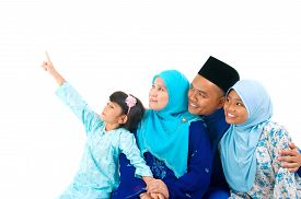 stock photo of malay  - Malay family looking to the side isolated on white background - JPG