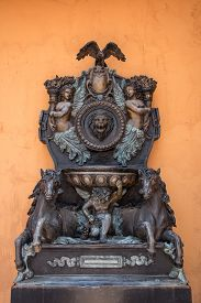 picture of cupid  - closed up the cupid and horse sculpture with orange wall - JPG