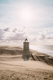 pic of sandstorms  - Sandstorm at the lighthouse Rubjerg Knude in North Jutland Denmark - JPG