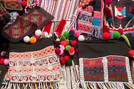 picture of tunic  - The colorful dress of Mien women Hill Tribe minority  show on basket are unmistakable for they wear a long black tunic with a bright red ruff around their neckline - JPG