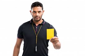 stock photo of referee  - Referee showing a yellow card isolated on white - JPG