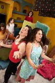 picture of misbehaving  - Frustrated mom and babysitter among misbehaving little girls at a sleepover - JPG