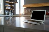 Laptop on kitchen counter at home poster