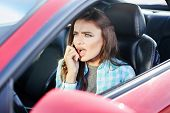 Annoyed Woman Talk On Phone Inside Car poster