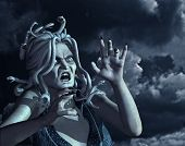 image of medusa  - An angry Medusa against a raging dark sky  - JPG