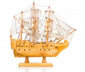 picture of tall ship  - wooden toy sailing boat on white background - JPG