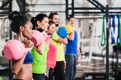 Functional fitness workout in sport gym with kettlebell poster