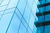 Abstract Modern Architecture Fragment, Walls Made Of Steel And Shiny Blue Glass With Sky Reflections poster