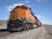 image of locomotive  - A freight train traveling across Northern New Mexico on a clear blue day - JPG
