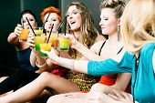 picture of leggy  - Women or models in club or disco drinking cocktails having fun - JPG