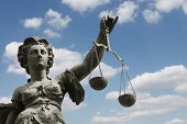 image of figurine  - statue of justice in frankfurt germany with blue sky - JPG