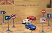 Travel Concept. Toy Cars On Vintage World Map With Road Sign. Newspaper As A Background. poster
