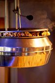 Cooking Steaming Popcorn In The Cinema Machine. Metal Bowl And Steam. poster