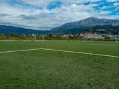 On The Football Field. Behind The Goal Of A Soccer Field. Soccer Football Net Background Over Green  poster