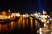 Abstract City Lights Background. Defocused Urban Background At Night poster