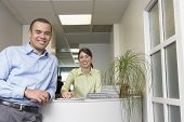 stock photo of pacific islander ethnicity  - Portrait of male doctor and receptionist in office - JPG