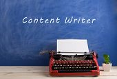 Writers Workplace - Red Typewriter On Blue Blackboard Background With Text content Writer poster