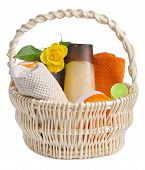 set of toiletries in basket isolated  on white background