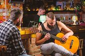 Hipster Brutal Bearded Spend Leisure With Friend In Bar. Real Men Leisure. Man Play Guitar In Bar. F poster