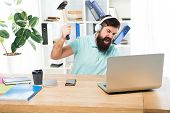 Man Bearded Guy Headphones Office Swing Hammer On Computer. Slow Internet Connection. Outdated Softw poster