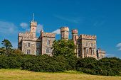 Lews Castle On Blue Sky In Stornoway, United Kingdom. Castle With Green Trees On Natural Landscape.  poster
