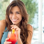Happy Beautiful Woman Holding Glasses With Fresh Juice At Aperitif