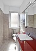 stock photo of lavabo  - Red bathroom with toilette bidet heater lavabo and mirror in soft hdr - JPG