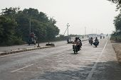 Motorcycles And Tuk-tuks On Covered By Haze Route, Central India