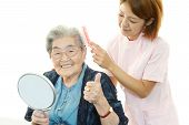stock photo of polite girl  - Friendly nurse cares for an elderly woman - JPG