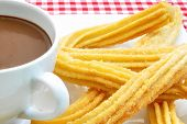 pic of churros  - Traditional spanish churros with a cup of thick hot chocolate - JPG