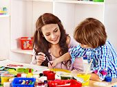 stock photo of indoor games  - Family with children  painting  in school - JPG