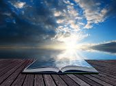 pic of hazy  - Creative concept pages of book Stunning landscape at sunset reflected in ocean - JPG