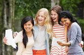 foto of 15 year old  - Four Teenage Girls Celebrating Successful Exam Results - JPG
