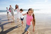 foto of grandparent child  - Multi Generation Family Having Fun On Beach Holiday - JPG
