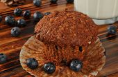 stock photo of flaxseeds  - A fresh bran and flaxseed muffin with organic blueberries and milk - JPG