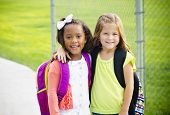 stock photo of little school girl  - Two little kids going to school together - JPG