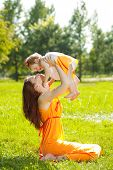 pic of mother baby nature  - Beautiful Mom and baby outdoors - JPG