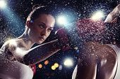stock photo of boxing ring  - Two young pretty women boxing standing against flashes background - JPG