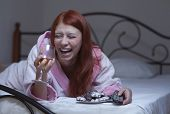 image of hysterics  - redhead woman in hysterical depression watch tv with vine - JPG