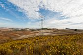 stock photo of plowed field  - Power Line on the Plowed Field in Spain - JPG